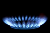 Close up of a gas burner isolated on black background poster