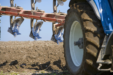 Close up of tractor and plough in field