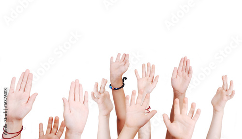 Many children hands high up isolated