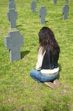 woman at a headstone poster