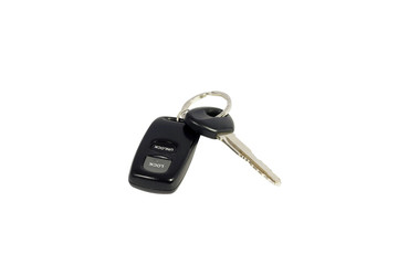 Automobile key with a charm