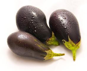three eggplants isolated on white