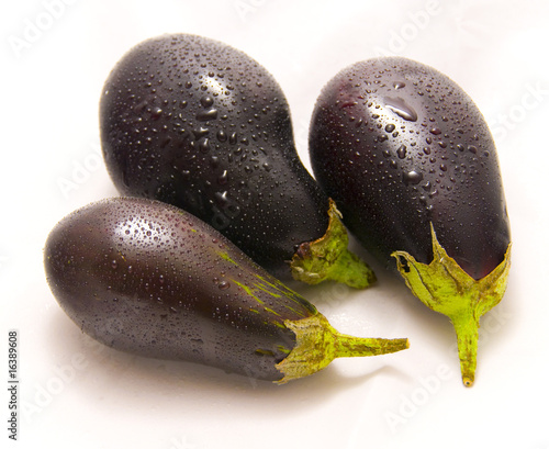 three eggplants isolated on white