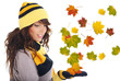 Beautiful  woman wearing hat and gloves. leaves background
