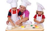 Grandmother teaching kids how to make cookies poster