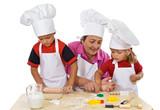 Grandmother teaching kids making cookies poster