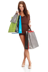Beautiful woman with colorful shopping bags in her hand