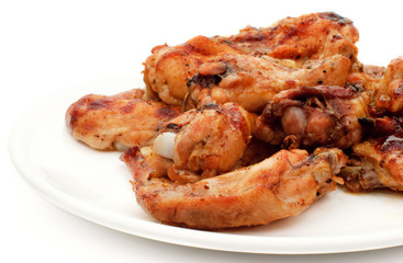 Grilled chiken legs on plate