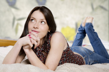 Attractive young woman Lying On A Couch