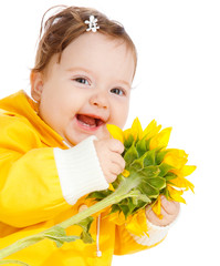 Laughing baby with sunflower