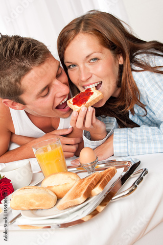 Young happy couple having luxury hotel breakfast