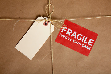 A Shipping box with a blank tag and a Fragile Sticker