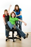 Women playing on office chair