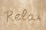 Relax handwritten in sand for natural, symbol,tourism poster