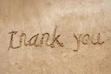 Thank you handwritten in sand for natural, symbol,tourism poster
