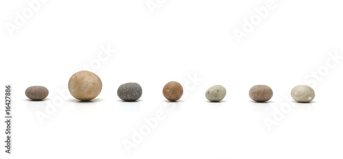 row of seven pebbles, one larger than the others