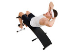 Young man exercise on bench working on abdominal muscles poster