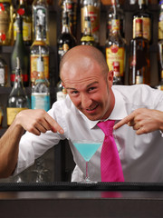 Bartender showing a cocktail.