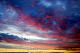 sunset with clorful clouds over the baltic sea poster