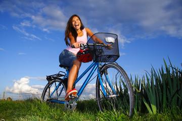 Biking woman excited