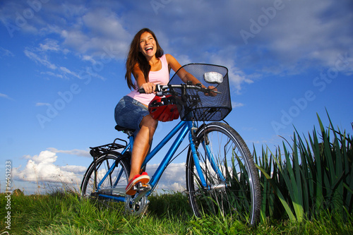 Biking woman excited