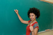 african american student in classroom thumbs up
