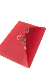 Opening a christmas card in red envelope isolated on white