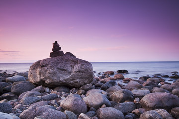 Beautiful coast sun-dawn. Piling of rocks.