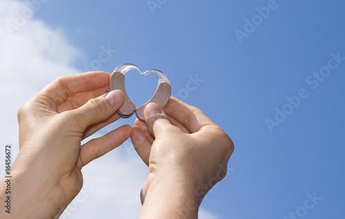 Showing a heart from hearing aids - 16456672