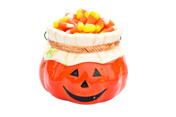 Jack o' lantern filled with Halloween candy with clipping path.