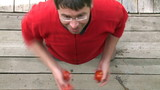 Overhead view of a man juggling with tomatoes poster