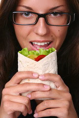 beautyful woman eating fresh tortilla