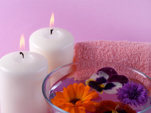 candles, bowl of water and flowers