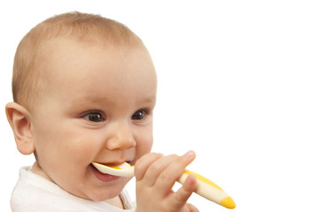 Baby feeding himself with spoon