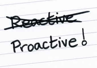 Crossing out reactive and writing proactive.