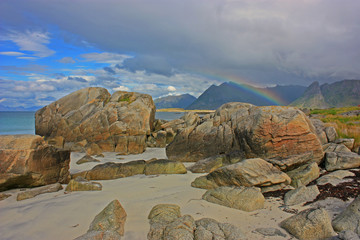 Beach with rainbow in lofoten