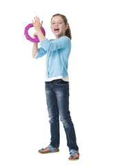Pretty young girl playing tambourine on white background