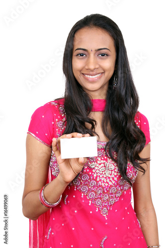 Young teenager holding a name card.