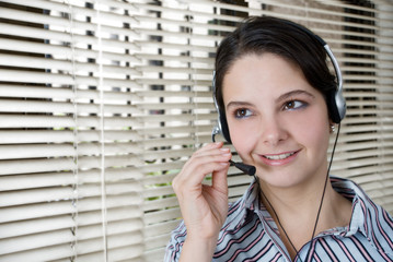 Pretty girl smiling with headphones and looking away