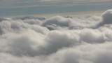 Beautiful, dream-like flight over fluffy clouds. poster