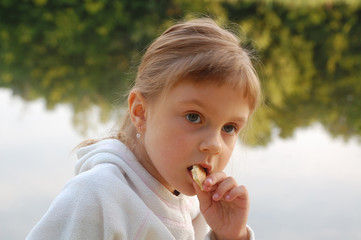 child eating outdoor