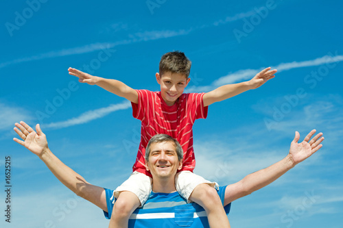 father and his son play outdoors Poster