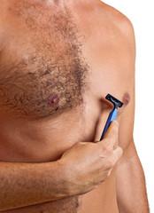 unshaved man with razor