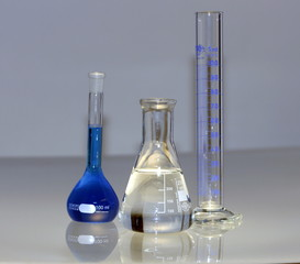 flask, cylinder with liquids in chemical laboratory