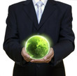 Businessman holding green planet full of lights