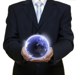 Businessman holding blue planet full of lights