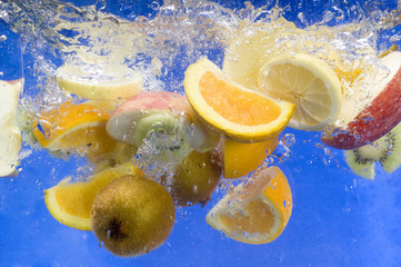 lot of fresh fruit splashing in fresh water