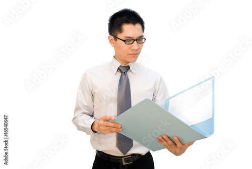 Asian busines male composed looking at report