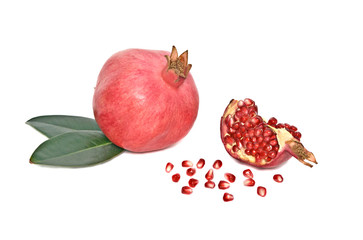 Ripe pomegranate and its piece isolated on white background