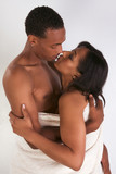 Ethnic young couple wrapped in white bath towel